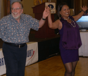 Gov. Neil Abercrombie dances with House Majority Floor Leader Rida Cabanilla (courtesy Facebook)