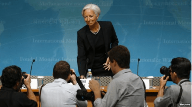 Photographers follow International Monetary Fund (IMF) Managing Director Christine Lagarde as she arrives to discuss the IMF's annual review of the U.S. economy in Washington, June 16, 2014.