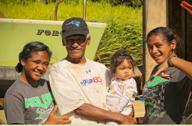 Yama Kaholo'a'a shares a moment at home with the three granddaughters (from left to right: Shandalyn, age 13, Caroline, 15-months old and Makaila, age 14) he and his wife, Caroline, are raising.