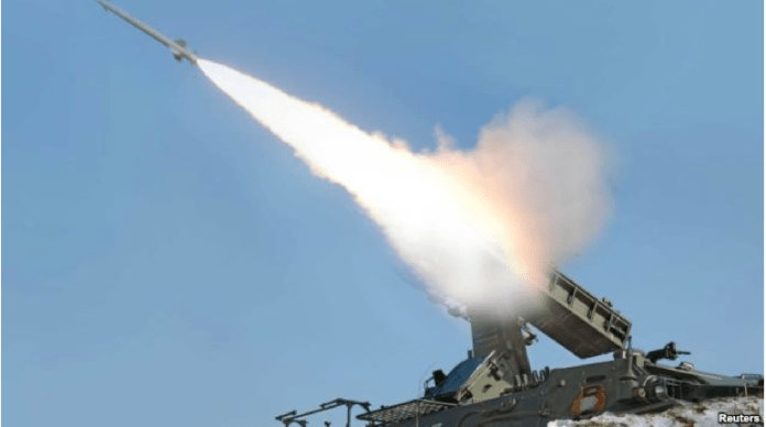 "FILE - A rocket is fired during a drill of a self-propelled flak rocket destroying ""enemy"" cruise missiles conducted by the air defense artillery units of the Korean People's Army in an undisclosed location in North Korea."