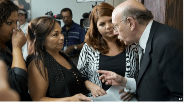 Kenneth Feinberg, the independent claims administrator for the GM Ignition Compensation Program, right, meets with family members of crash victims in Washington on June 20, 2014.