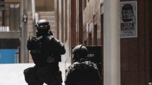 Police anti-terror forces are seen dispatched in Martin Place, in the central business district of Sydney, Australia, Dec. 15, 2014.