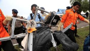 National Search and Rescue Agency personnel carry the seats of AirAsia Flight 8501 after being airlifted by a U.S. Navy helicopter at the airport in Pangkalan Bun, Indonesia, Jan. 5, 2015.
