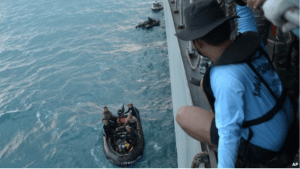Indonesian navy divers prepare operations to lift the tail of AirAsia Flight 8501 in Java sea, Indonesia Friday, Jan. 9, 2015.