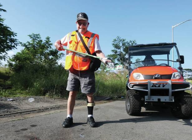 Menke helping keep Hawaii beautiful by picking up trash from the roadside