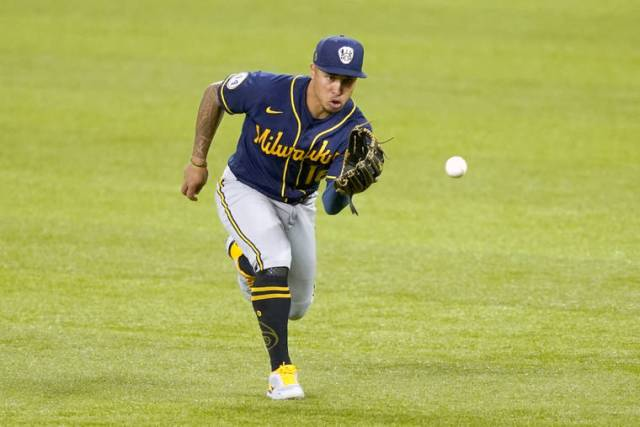 Powered by 'dad strength,' Kolten Wong primed for debut with Brewers