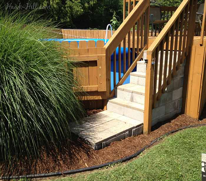 Hiding A Big Blue Above Ground Pool In A Landscaped Backyard