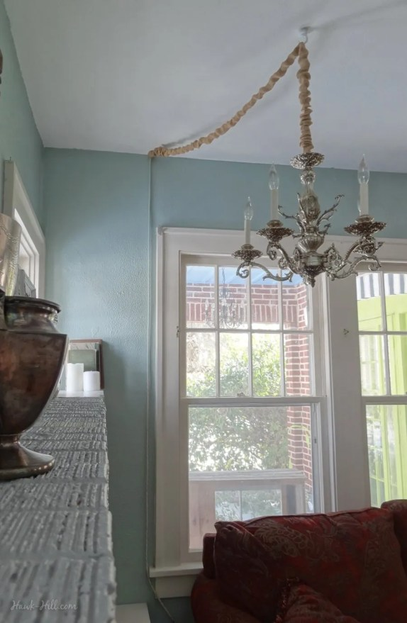 chandelier light fixture hung from cieling without a hardwired outlet