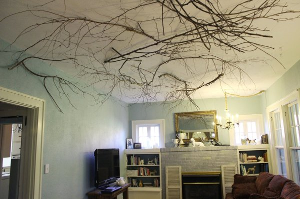 Use branches to break up the angular lines of a high ceiling and add warmth to a room