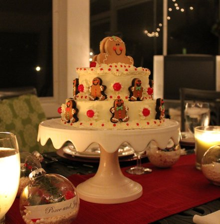 Gingerbread Man Cake - 2 teir vanilla cake embellished with decorated gingerbread cookies