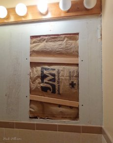 DIY drywall repair where large medicine cabinet was removed from bathroom wall