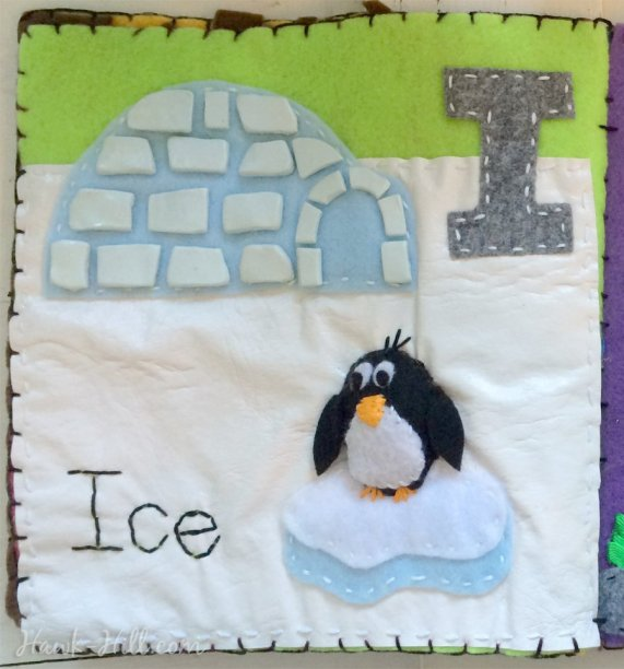 "My quiet book's ""I"" page features a penguin and a igloo made from polymer clay ""ice""."