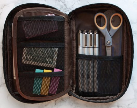 My pen case, flipped to scissor and pen section