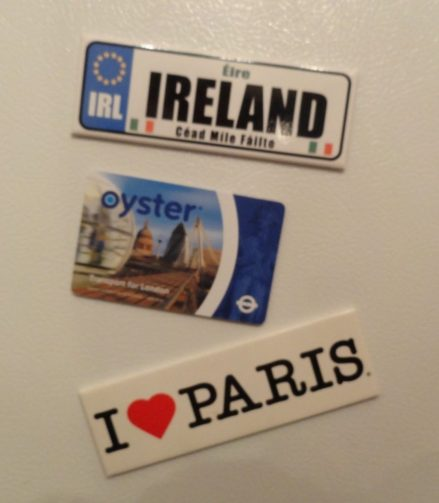 Glue magnets to the back of travel souvenirs to create travel-themed magnets