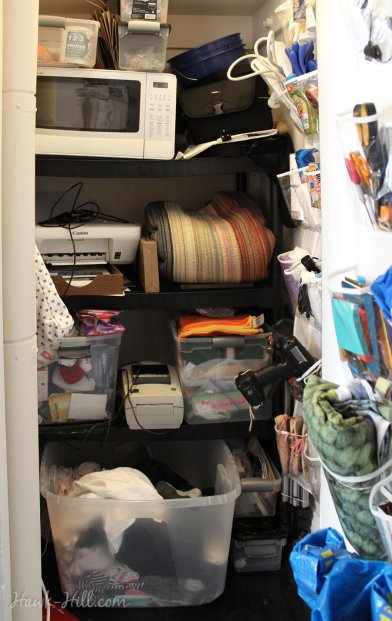 Deliberately placing my ugliest stuff on a shelf in my only closet meant I could have my living space free from eyesores