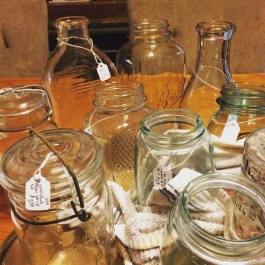 prepping jars for pricing and putting in flea market booth