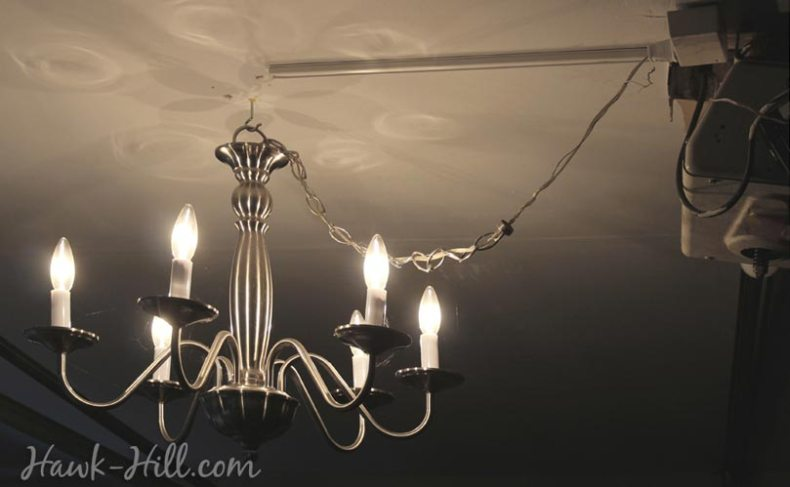 lighting a garage with chandeliers is easy