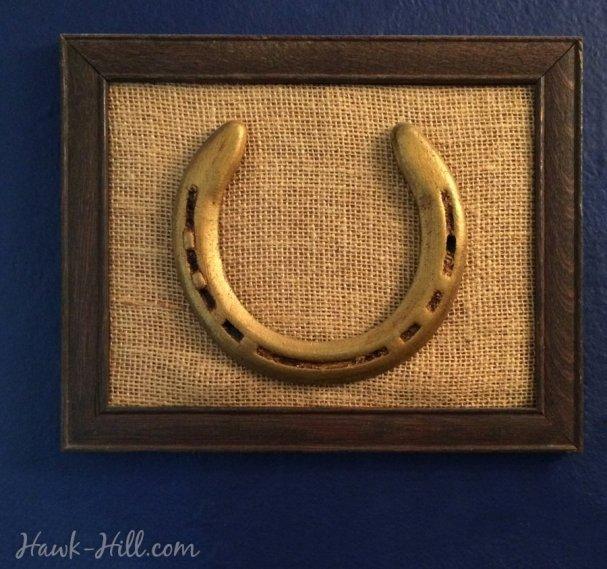 framed gold equestrian horse shoe