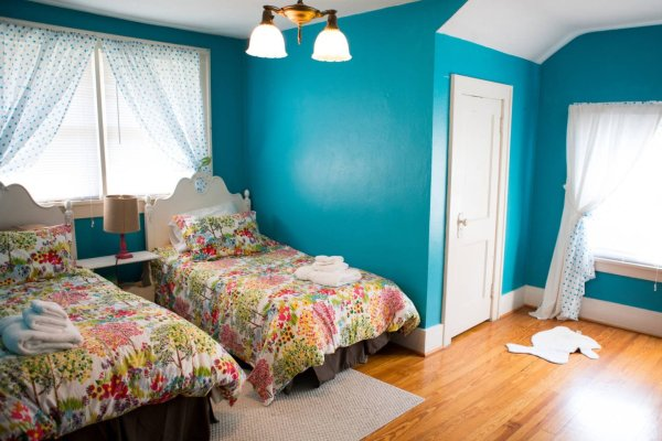This turquoise double twin bedroom featured pottery barn bedding and an original 100 year old light fixture.