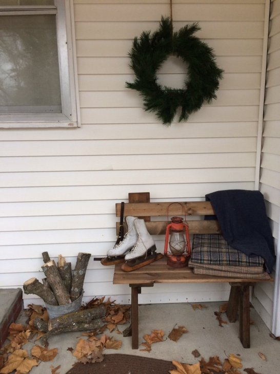 Simple homemade porch decorations transition effortlessly from fall to winter and into early spring.