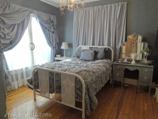 anthropologie rosette quilt, vintage furniture, and romantic curtains in my master bedroom