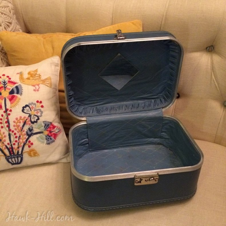 A blue vintage cosmetic case