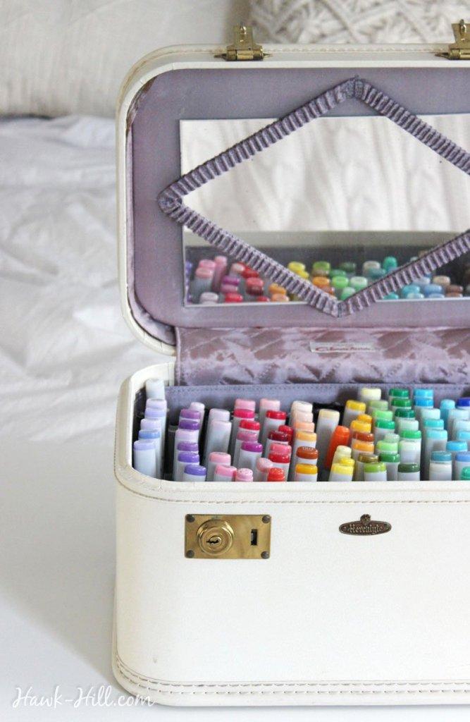 Using a vintage train case for art supply marker storage