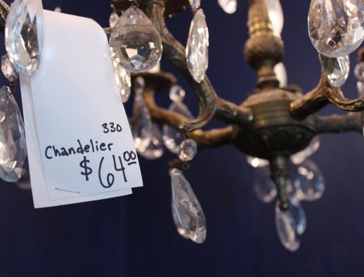 Chandeliers sell well in a flea market, large pricetags discourage excessive handling of these fragile items.