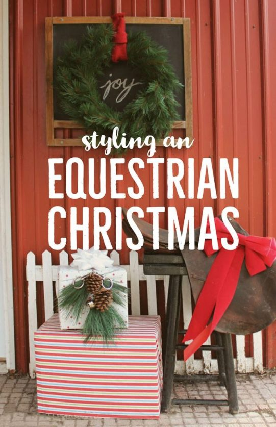 Outdoor Christmas Decorations outside of horse stable entrance- saddle and package decorated with snaffle bit