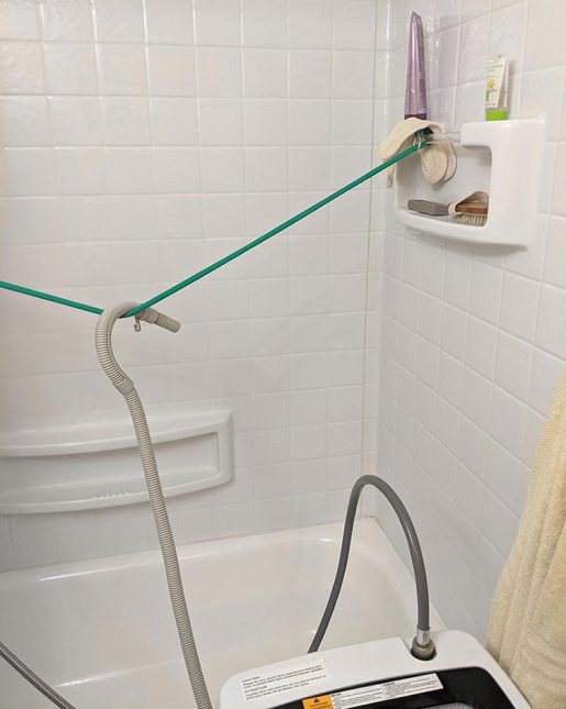 The drain hose needs to be placed in a position where it won't shift when water is pumped through it at velocity. Using a resistance band to hold mine over the tub, with tension, keeps the water draining safely over the tub