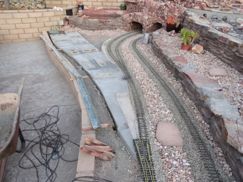 small resolution of concrete fills area between cinder blocks to give track and ballast a firm foundation to sit on