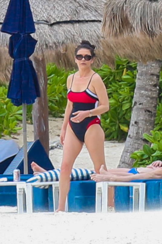 CATHERINE ZETA JONES in Swimsuit on the Beach in Cancun 03