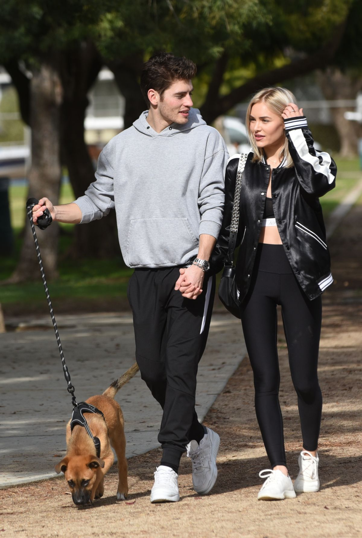 MICHELLE RANDOLPH mad Gregg Sulkin with Their Dog at a