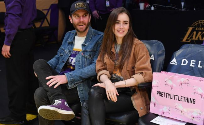 Lily Collins And Charlie Mcdowell At Cleveland Cavaliers