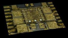 שבב הסיליקון-גרמאניום שפותח במרכז המחקר של חברת IBM. צילום: יבמ