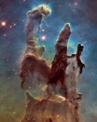 """אסטרונומים השתמשו בטלסקופ החלל האבל כדי לצלם תמונה חדה וגדולה יותר של ערפילית הנשר – """"עמודי הבריאה"""". צילום:NASA/ESA/Hubble Heritage Team (STScI/AURA)/J. Hester, P. Scowen (Arizona State U.)"""