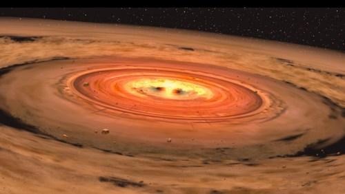 הדמיה של דיסקת אבק המקיפה ננס אדום. איור: NASA/JPL-Caltech/T. Pyle (SSC)