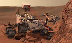 הדמייה של הרובר קיוריוסיטי יורה קרן לייזר אל עבר סלע במאדים. הלייזר מאייד חלק מהסלע, והרובר בוחן את ספקטרום הקרינה של הפלזמה שנוצרת כתוצאה מכך, על מנת לקבוע את ההרכב הכימי של הסלע. מקור: NASA / JPL.