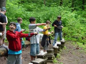 Campers Firing Slingshots Photo