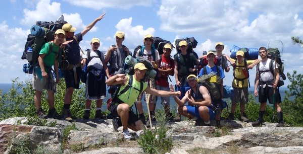 Campers Hiking Mountain