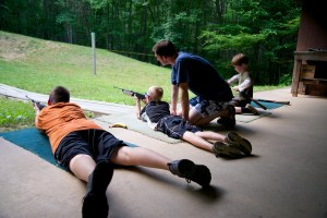 Marksmen Camp - Campers in prone position preparing to fire.