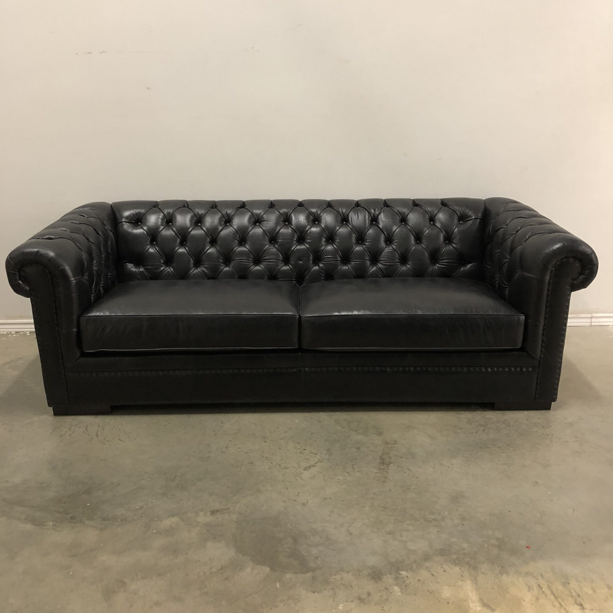 tufted leather sofa cheap black reclining and loveseat kennedy hayward s the best furniture st