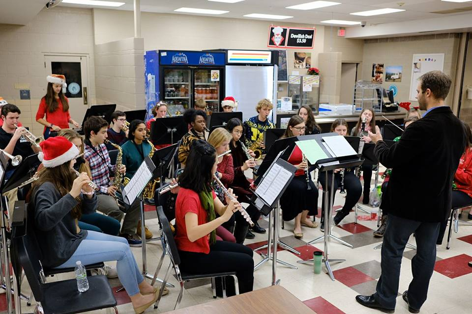 Extra-curricular musical ensembles such as Holiday Winds perform festive tunes for their peers and parents at Jingle bell Java, and often dress up in holiday colors and Santa-Hats.
