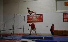 Girls gymnastics takes first at home meet