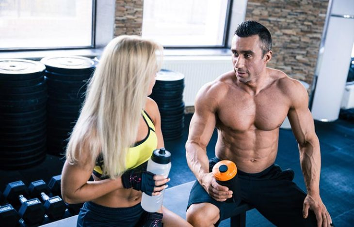 Man and woman talking inside the gym