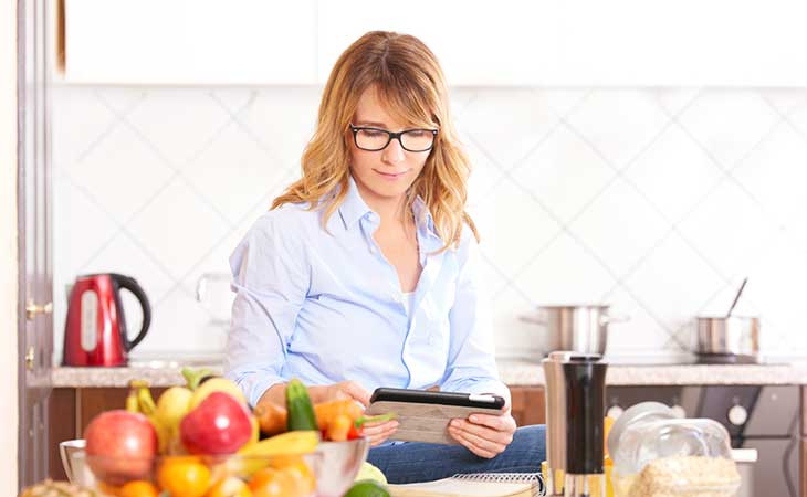 Woman Reading And Understanding Fad Diet