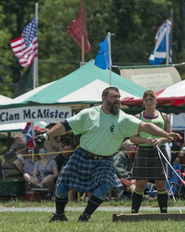 Brent Miller, 61st annual Grandfather Mountain Highland Games professional Scottish athletics champion, sends a 56-pound weight 17 feet in the air. Photo by Skip Sickler   Grandfather Mountain Stewardship Foundation