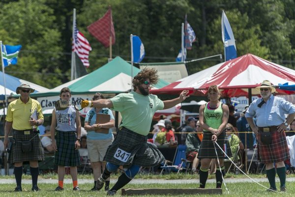 Wes Kiser prepares to throw a 56-pound weight for distance at the 61st annual Grandfather Mountain Highland Games. Kiser finished second overall in the professional Scottish heavy athletics portion of the Games. Photo by Skip Sickler   Grandfather Mountain Stewardship Foundation