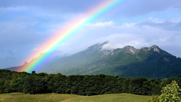 Fast-moving weather on Tuesday afternoon placed a rainbow over Grandfather Mountain.  Photo by Jim Morton