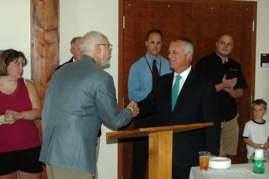 AppalCART Transportation Director Chris Turner introduces NCDOT Secretary Tony Tata with a handshake. Photo by Jesse Wood